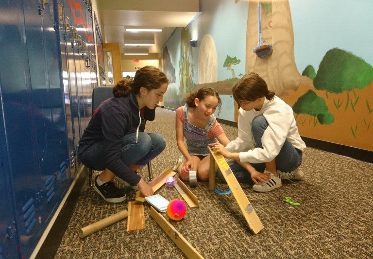 Saturday Academy students working on a Rube Goldberg machine