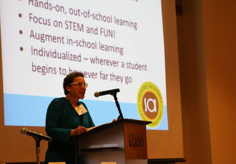 Jeri Janowsky, Saturday Academy Executive Director, speaks at the 2019 Discovery Luncheon