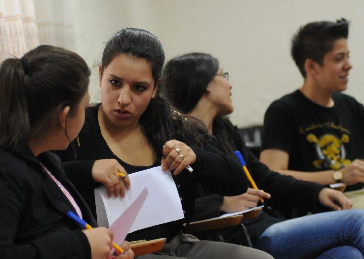 Students debating in Saturday Academy class