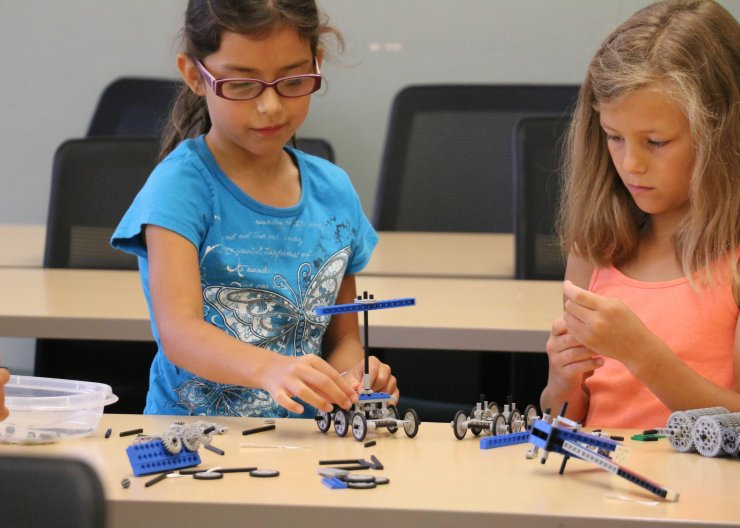 Saturday Academy students working with LEGOs in a summer camp