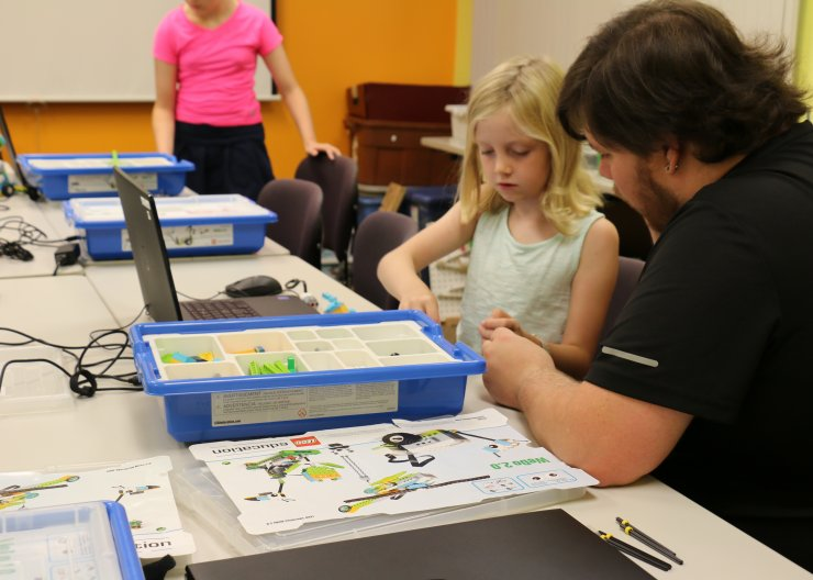 Girl and instructor working on LEGO project
