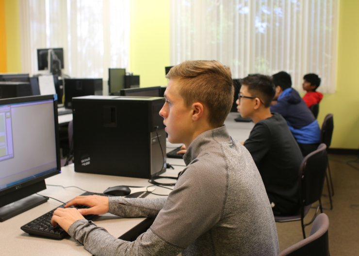 Students working on programming in a Saturday Academy class