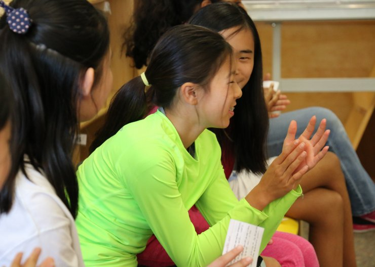 Students clapping for other students in a speech camp at Saturday Academy