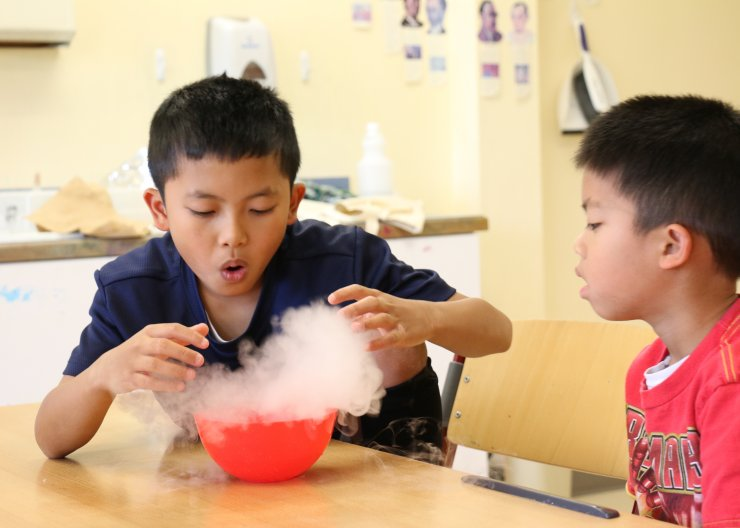 Two SA students experimenting with dry ice in a Wacky Weird Science summer camp