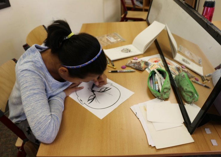 Student working on graphic novel in a Saturday Academy comics class