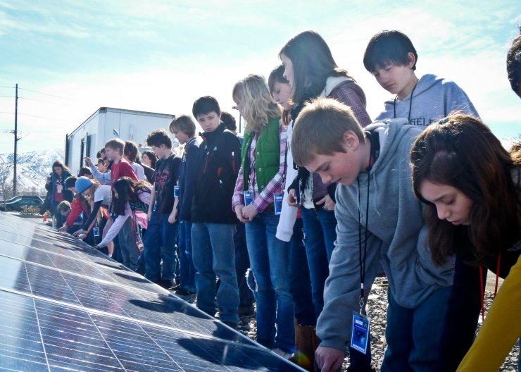 Saturday Academy camp students observing solar panels