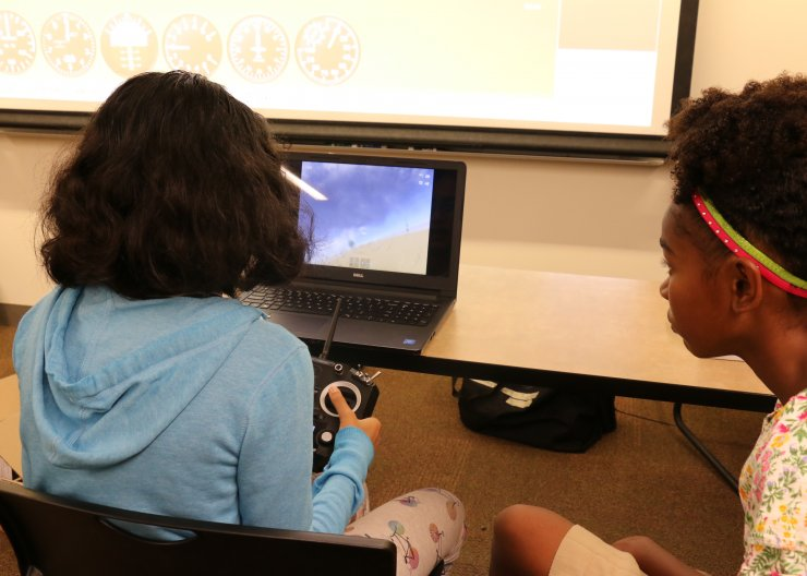 Girls playing a flight simulation in a Saturday Academy class
