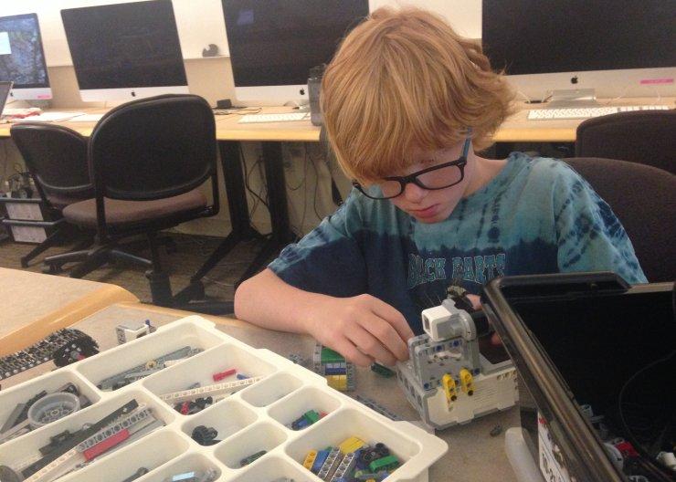 Boy working on LEGO robot