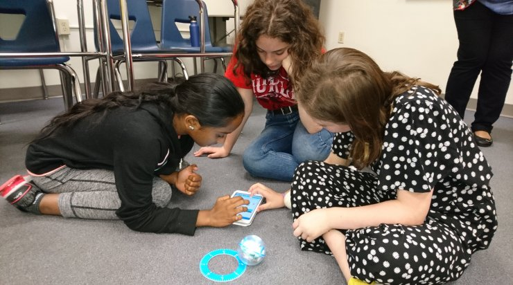 Students working with robots in a Saturday Academy class