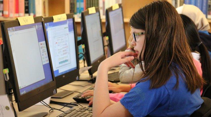 Girl at computer programming