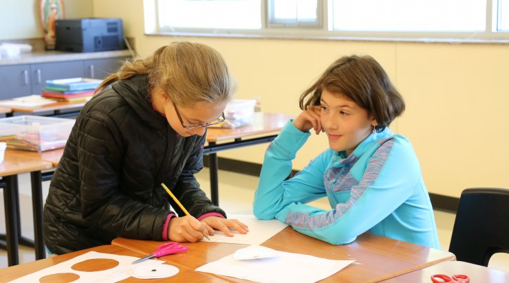 Girls working on math problem together