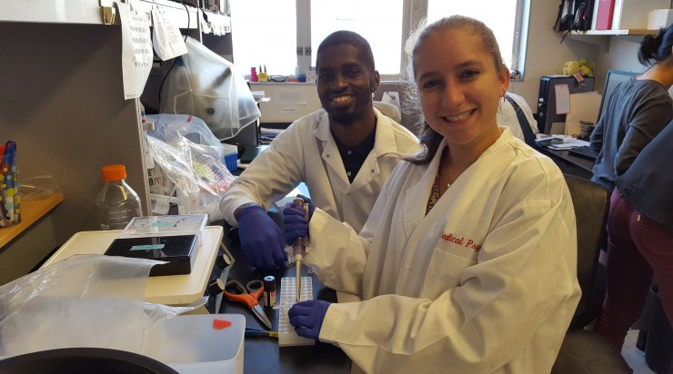 Teenager learning with a mentor at OHSU presented by SA