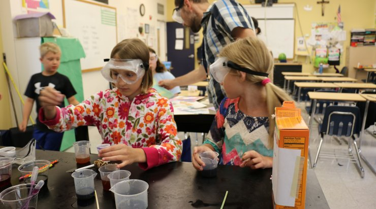 Two girls working on chemistry project at Saturday Academy class