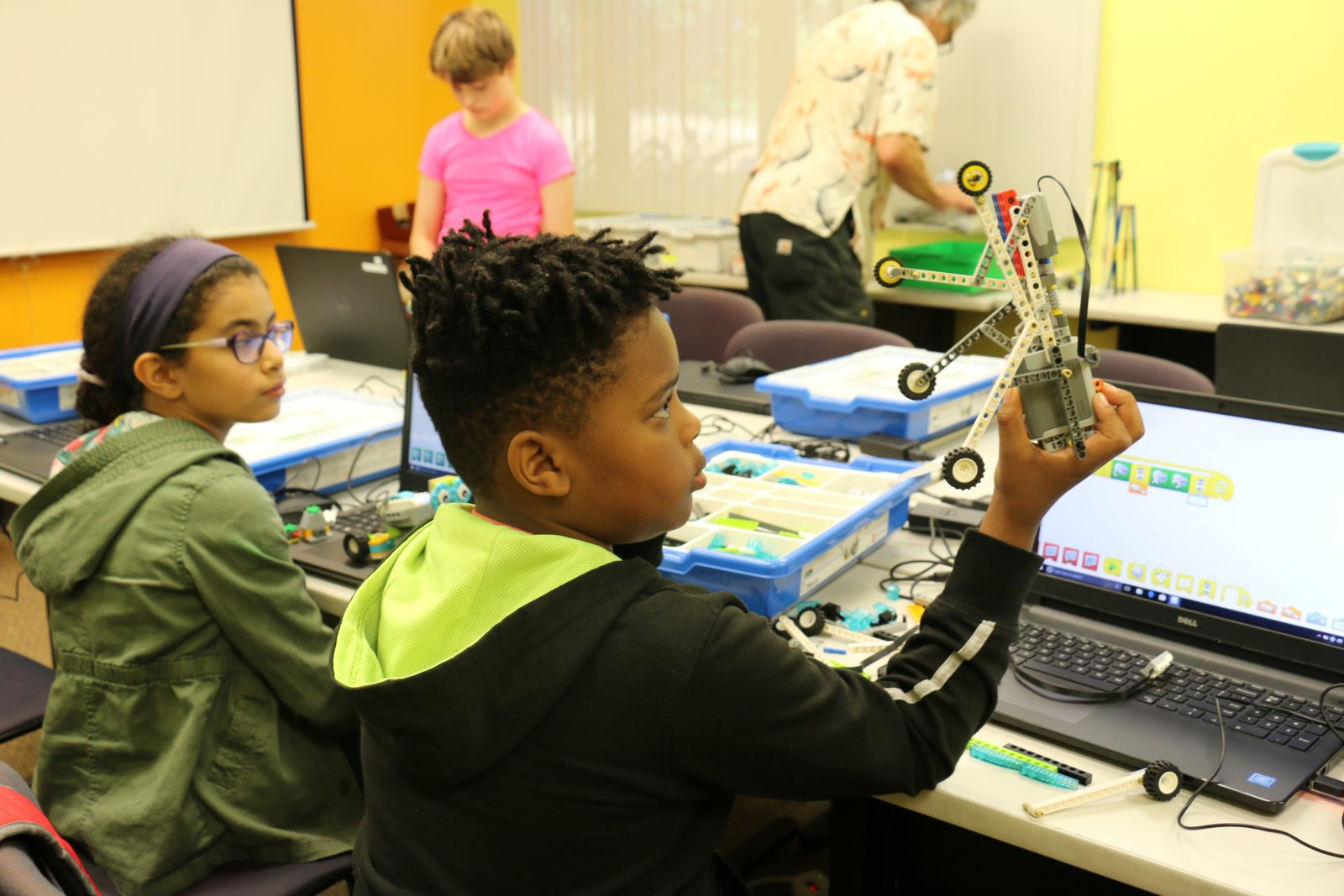 Students working with LEGOs in a Saturday Academy camp