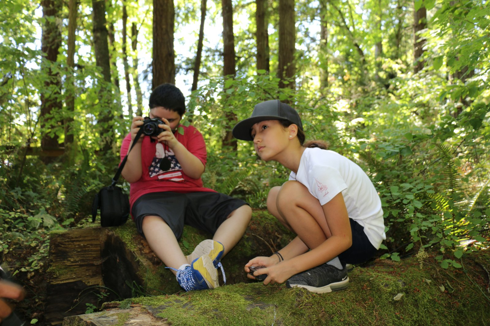 Kids taking photos of nature at Saturday Academy camp