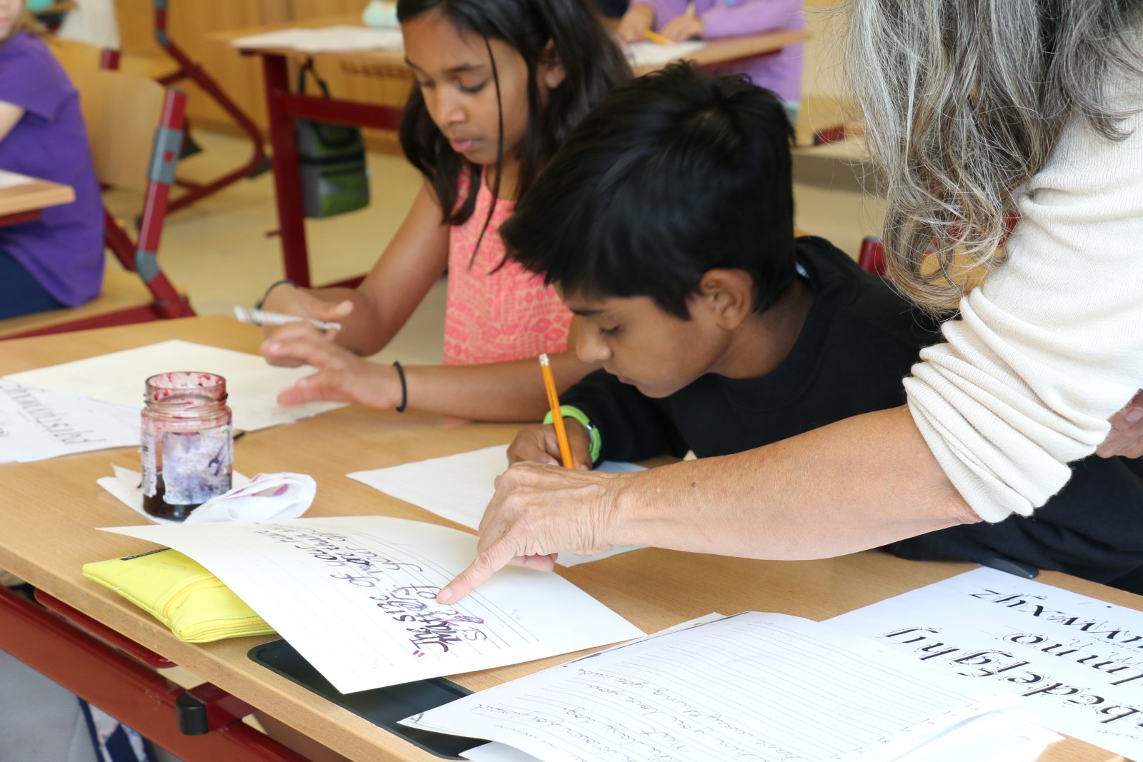 Students and instructor working on penmanship at Saturday Academy