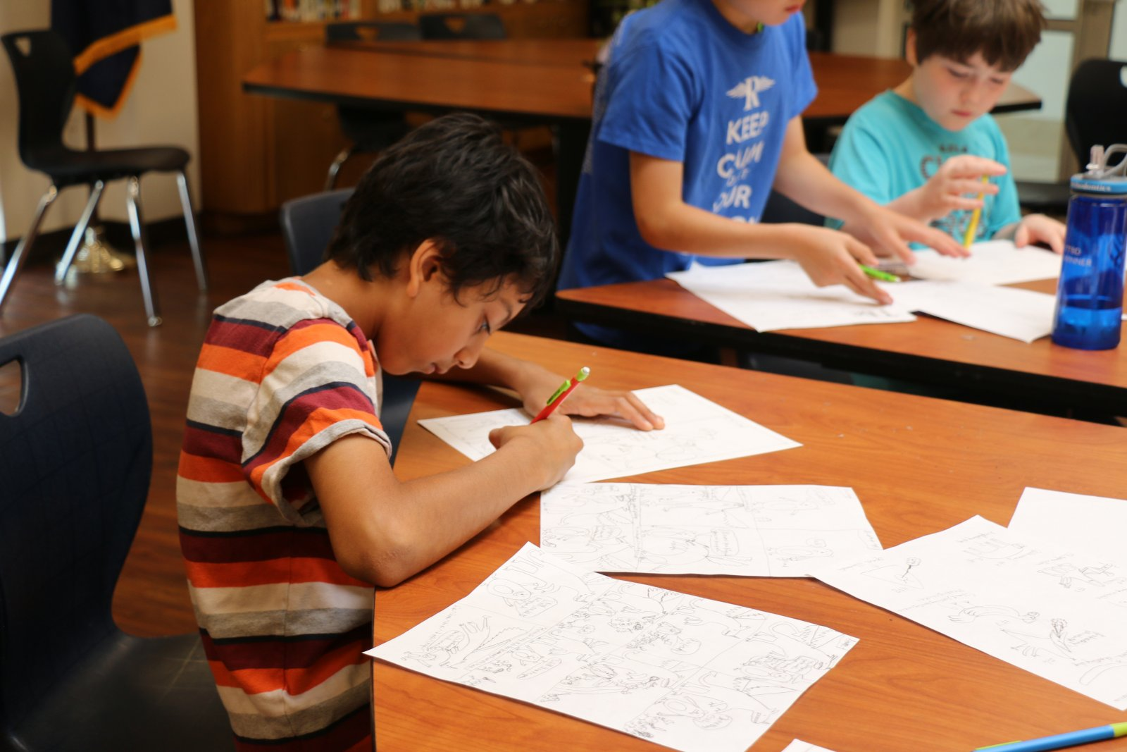 Saturday Academy student drawing a comic in a graphic novel class