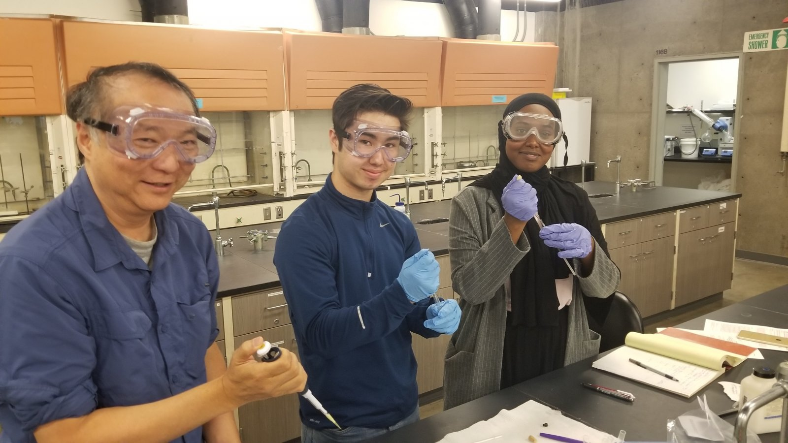 ASE intern working with their mentors in a lab
