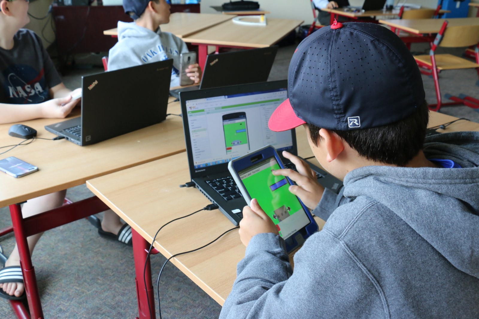 Student working on designing an app in a Saturday Academy class