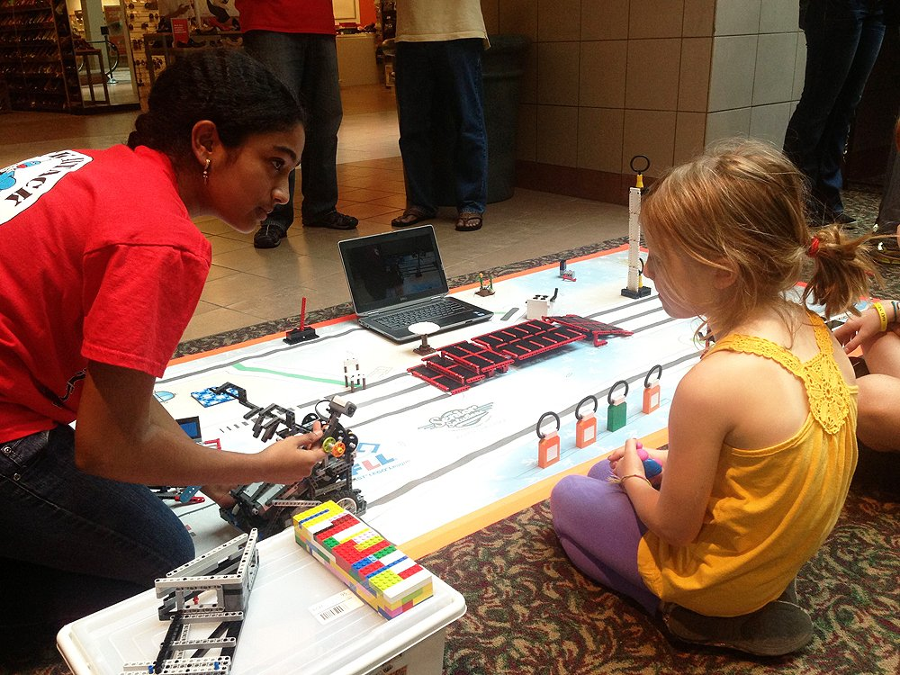 Saturday Academy student learning about engineering from instructor in a summer camp