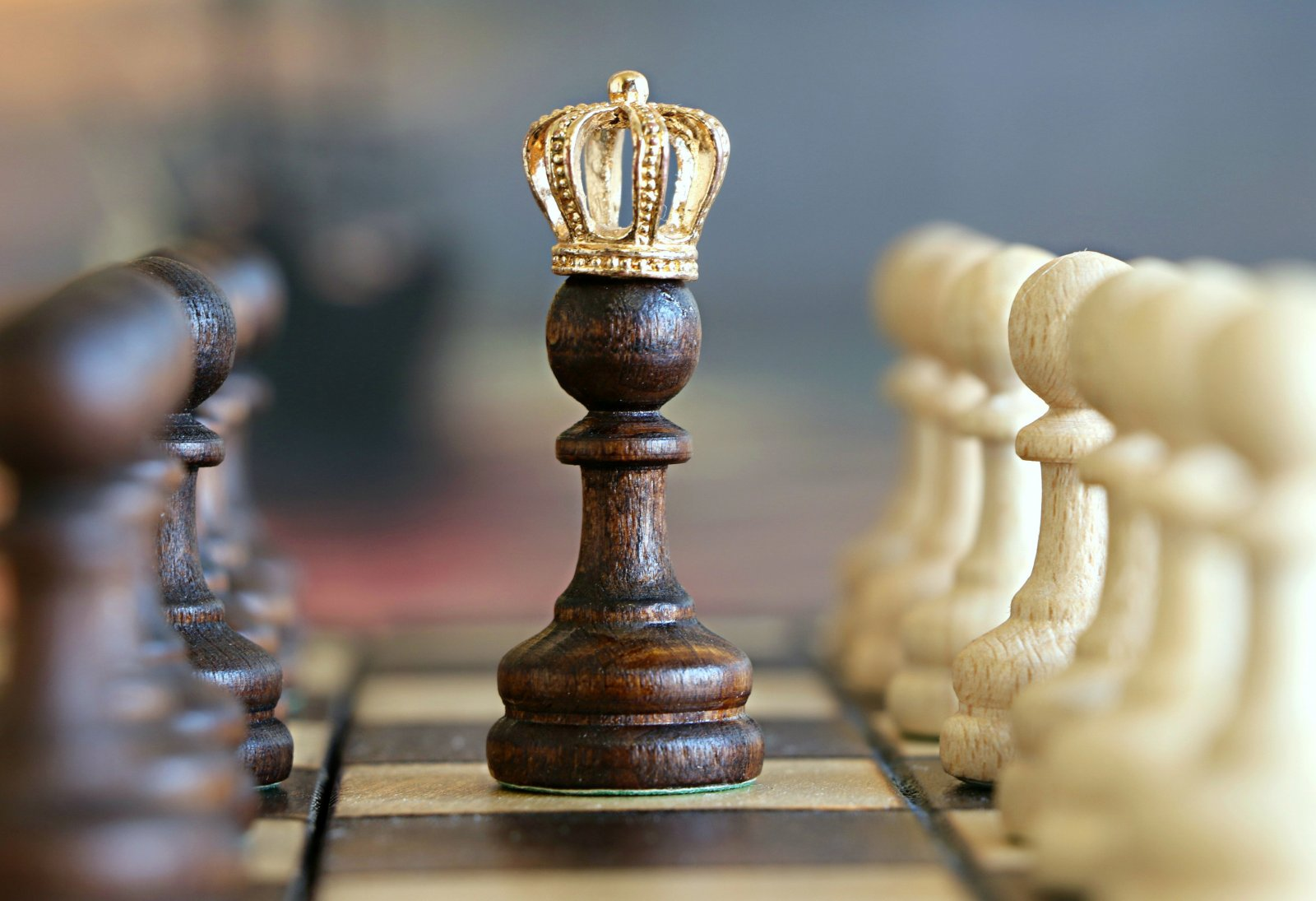 Chess board photo with a crowned pawn