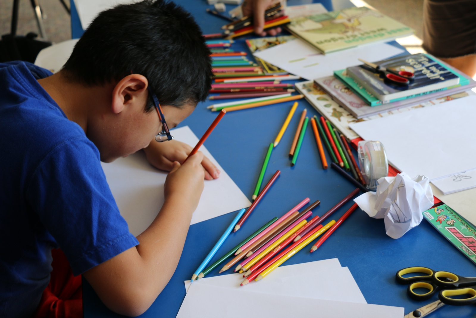 Saturday Academy student working on an illustration in an art class