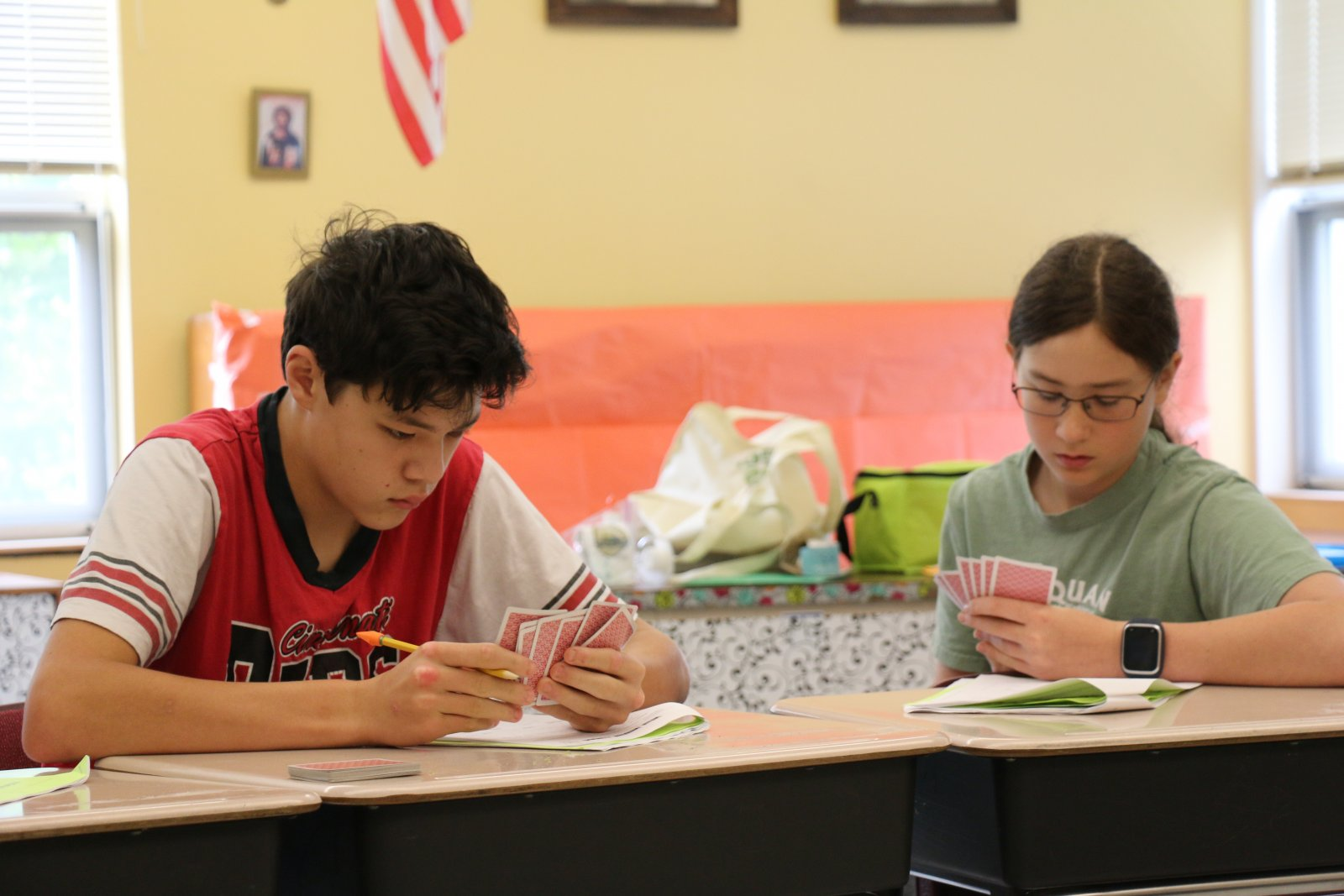 Two kids studying cards & learning math at Saturday Academy