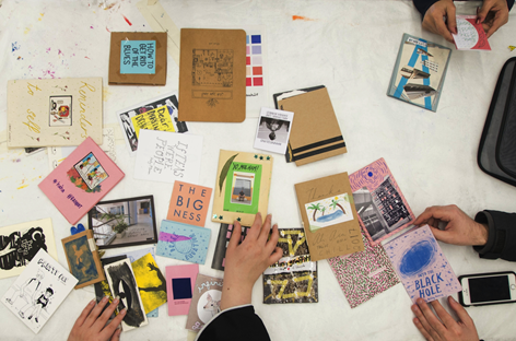 Students viewing zines in a Saturday Academy class